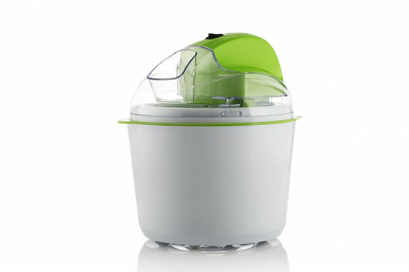 a white ice cream maker with green accents