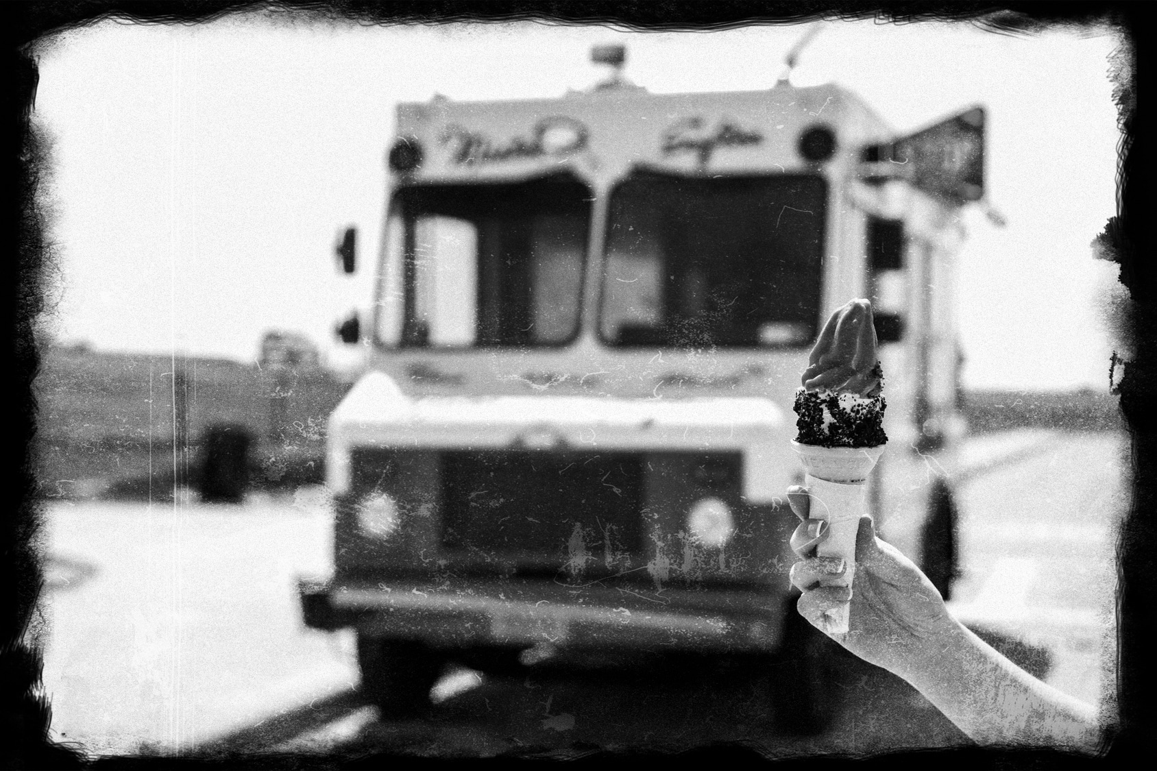 Old ice cream truck with ice cream cone