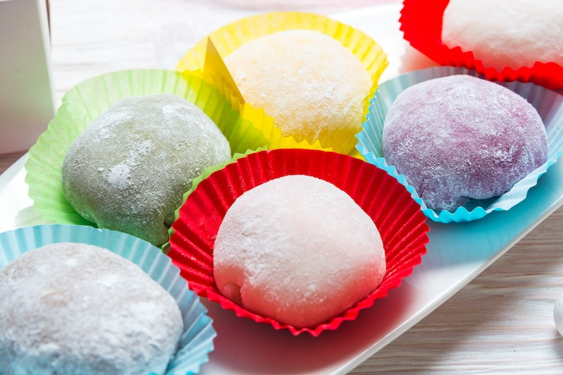 colorful pieces of mochi ice cream in cupcake liners