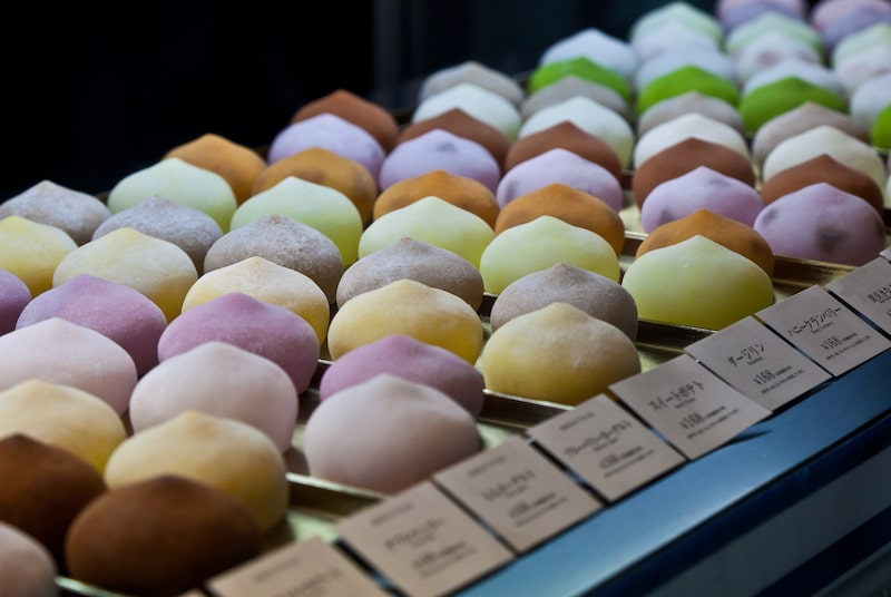 rows of colorful mochi ice cream in a display case